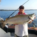showing off catch on dirty goose sport fishing trip